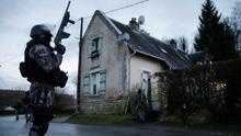 Members of the French GIPN intervention police secure a neighbourhood in Corcy, northeast of Paris, last night. Special forces have flooded the normally tranquil villages north of the French capital as the hunt for the 'Charlie Hebdo' gunmen entered its decisive phase. Pic. Reuters.