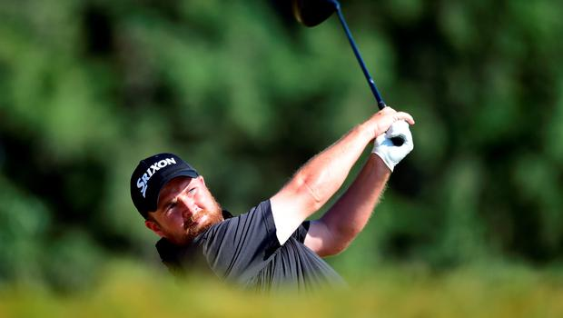 Shane Lowry of Ireland hits his tee shot on the 14th hole during the final round of the 115th U.S. Open Championship at Chambers Bay