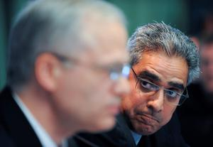Ajai Chopra, deputy director of the IMF;s European Department looks across at Istvan Szekely from the European Commisson during a press conference in April 2011