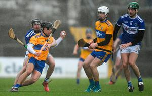 Clare's David Reidy looks for a way past John Lennon of Laois. Photo: Eóin Noonan/Sportsfile