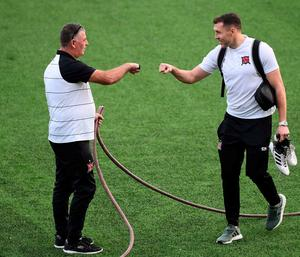 Groundsman Harry Taaffe exchanging pleasantaries with captain Brian Gartland. Photo: Sportsfile