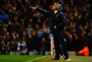 Manuel Pellegrini manager of Manchester City gives instructions during the Barclays Premier League match between Manchester City and Chelsea