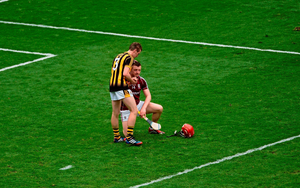 Kilkenny captain Joey Holden consoles Joe Canning, Galway, after the game