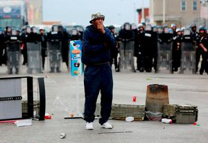 A man stands in front of a police line during clashes in Baltimore, Maryland Maryland. Photo: Reuters