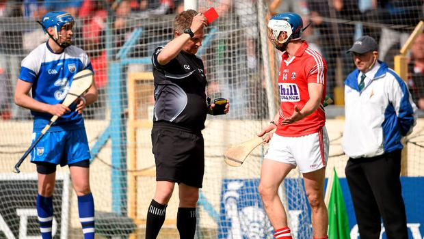 Cork's Luke O'Farrell receives a red card from referee Barry Kelly
