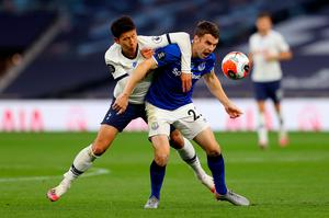 Tottenham Hotspur's Son Heung-min (left) and Everton's Seamus Coleman battle for the ball