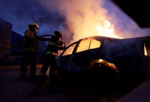Firefighters extinguish fire on a car after a protest in support of the missing students of Ayotzinapa Teacher Training College. Attorney General Jesus Murillo said three detainees, caught a week ago, admitted setting fire to a group of bodies in a dump near Iguala in the state of Guerrero, where the trainee teachers went missing on September 26 after clashing with local police (REUTERS/Daniel Becerril)