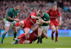 Brian O'Driscoll, Ireland, is tackled by Sam Warburton, right, and George North