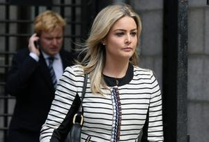 Blaise O Donnell, daughter of solicitor Brian O Donnell, pictured leaving the Four Courts earlier this week after a Supreme Court action - also in picture background, her brother, Blake. Picture: Collins Courts