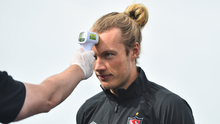 Gormanston native Greg Sloggett has his temperature taken ahead of Dundalk's training session at Oriel Park last Wednesday. Pictures: Sportsfile