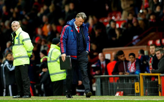 Manchester United manager Louis van Gaal walks off dejected after the game