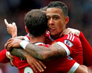 Manchester United's Memphis Depay celebrates after scoring their first goal