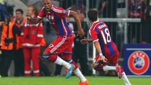 Jerome Boateng wheels away to celebrate with teammate Juan Bernat after his late strike gave Bayern Munich a Champions League victory over Manchester City at the Allianz Arena. Photo: Alexander Hassenstein/Bongarts/Getty Images
