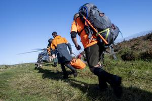 A team of search and rescue workers prepares to board a helicopter in the Kahurangi National Park in the South Island of New Zealand (CPL Naomi James/New Zealand Defence Force via AP)