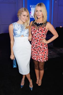Pixie Lott (L) and Laura Whitmore arrive at the Scottish fashion invasion of London at the 9th annual Scottish Fashion Awards at 8 Northumberland Avenue