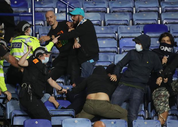 Police and Napoli fans clash after the match. Photo: Reuters
