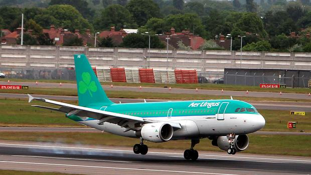An Aer Lingus plane battles the strong wind when landing at Heathrow Airport, London