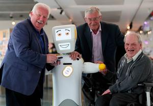 IrelandÕs first socially assistive AI robot 'Stevie II' from robotics engineers at Trinity College Dublin, with Mick McCarthy (left) Tony McCarthy (centre) and Brendan Crean, who all helped trial the robot through the charity ALONE, during a special demonstration at the Science Gallery in Dublin.  Brian Lawless/PA Wire