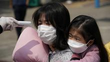 Ubiquitous: Voters in Seoul, South Korea, wearing masks, where they have the virus under control. Photo: REUTERS/Kim Hong-Ji