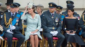 (L-R front row) Britain's Prince William, Duke of Cambridge, Britain's Catherine, Duchess of Cambridge, Britain's Prince Harry, Duke of Sussex, and Britain's Meghan, Duchess of Sussex attend a ceremony to present a new Queen's Colour to the Royal Air Force (RAF) at Buckingham Palace in London on July 10, 2018 to mark its centenary