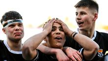 Newbridge players, from left, David O'Sullivan, Lucas Berti-Newman and Sam Prendergast celebrate after upsetting the odds in their Leinster Schools Senior Cup semi-final against St Michael's. Photo: Ramsey Cardy/Sportsfile