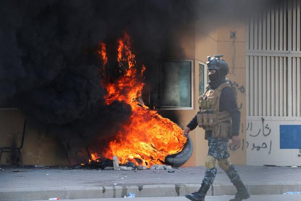 Protest: Tyres on fire near the US embassy in Iraq. Photo: Reuters/Thaier al-Sudani