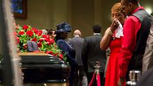 Lesley McSpadden reacts at the casket of her son Michael Brown during the funeral services at Friendly Temple Missionary Baptist Church in St. Louis, Missouri, August 25, 2014. REUTERS/Richard Perry/Pool