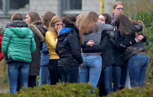 Students mourn in front of the Joseph-Koenig Gymnasium in Haltern, western Germany, Wednesday, March 25, 2015, one day after 16 school children and two teachers were among the 150 victims that died in the Germanwings plane crash in the French alps on the way from Barcelona to Duesseldorf. (AP Photo/Martin Meissner)
