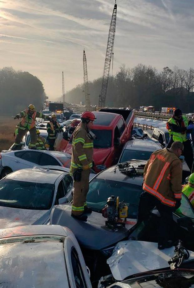 This handout image released by the York-Poquoson Sheriff's Office on Facebook shows first responders working at the site of an accident on the I-64 highway in York County near Williamsburg, Virginia, on December 22, 2019. (Photo by HANDOUT/YORK-POQUOSON SHERIFF'S OFFICE/AFP via Getty Images)