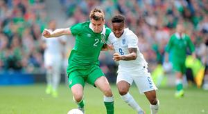 England's Raheem Sterling (right) and Republic of Ireland's Seamus Coleman battle for the ball during the international friendly at The Aviva Stadium