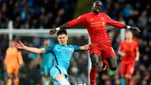 Manchester City's John Stones slides in to tackle Liverpool's Sadio Mane. Photo: Getty Images