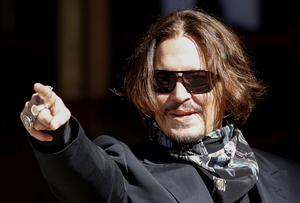 Actor Johnny Depp gestures as he arrives at the High Court in London, Britain, July 20, 2020. REUTERS/John Sibley