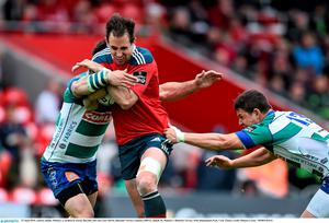 25 April 2015; Andrew Smith, Munster, is tackled by Enrico Bacchin, left, and Luca Morisi, Benetton Treviso. Guinness PRO12, Round 20, Munster v Benetton Treviso. Irish Independent Park, Cork. Picture credit: Ramsey Cardy / SPORTSFILE