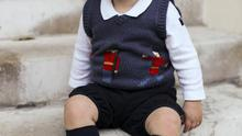 December 2014: Prince George poses for his official Christmas photograph.