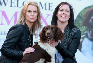 Peggy Mangan's daughters Louise Hollywood and Orla Lynch with Max at the handing over of search and rescue dog Max by the Peggy Mangan foundation to Dublin Civil Defence. Picture: Arthur Carron
