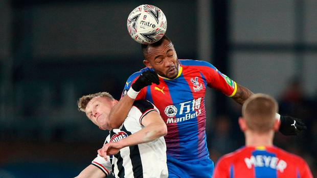 Crystal Palace's Jordan Ayew in action with Grimsby's Luke Hendrie. Photo: Ian Walton/Reuters