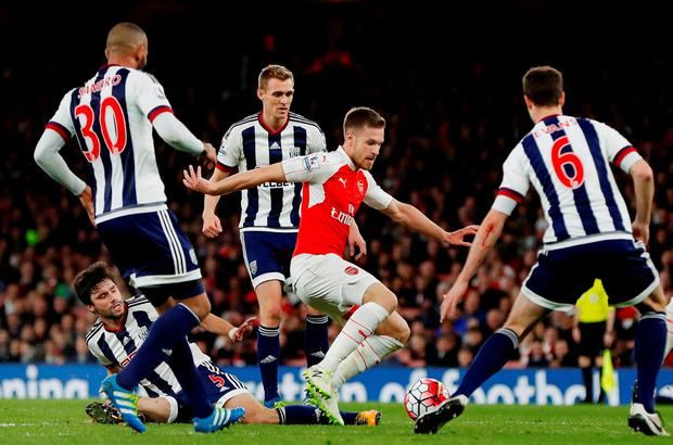 Arsenal's Aaron Ramsey in action as West Brom's Darren Fletcher, Claudio Yacob and teammates look on. Photo: Paul Childs/Reuters