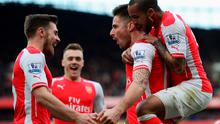 LONDON, ENGLAND - MARCH 14:  Olivier Giroud of Arsenal celebrates scoring the opening goal with Theo Walcott (R) and Aaron Ramsey during the Barclays Premier League match between Arsenal and West Ham United at Emirates Stadium on March 14, 2015 in London, England.  (Photo by Jamie McDonald/Getty Images)
