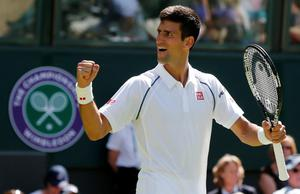 Novak Djokovic of Serbia celebrates after winning his match against Philipp Kohlschreiber of Germany at the Wimbledon Tennis Championships in London, June 29, 2015