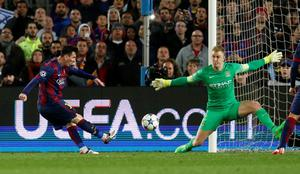Football - FC Barcelona v Manchester City - UEFA Champions League Second Round Second Leg - The Nou Camp, Barcelona, Spain - 18/3/15 Manchester City's Joe Hart saves from Barcelona's Lionel Messi Action Images via Reuters / Carl Recine Livepic EDITORIAL USE ONLY.