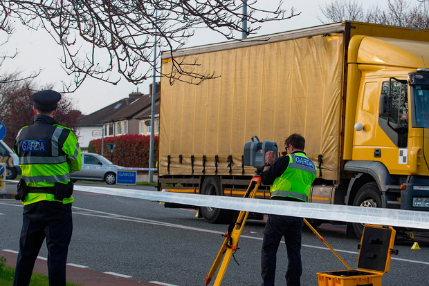 Gardai investigate a road traffic accident between a truck and a cyclist on Templeville Road in Terenure, Dublin. Picture:Arthur Carron