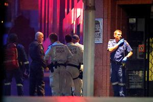Police surround the Lindt Chocolate Cafe, Martin Place.  (Photo by Joosep Martinson/Getty Images)