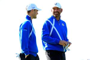 Thomas Bjorn (R) of Europe talks to Martin Kaymer of Europe on the 13th hole during the Morning Fourballs of the 2014 Ryder Cup on the PGA Centenary course at Gleneagles