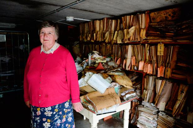 Solicitor Katherine O'Doherty in her ruined office basement. Picture: Caroline Quinn