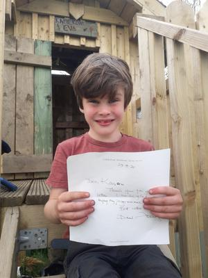 Kameron Durkin (7)from from Dowra, Co Leitrim, with the letter he received from David Attenborough