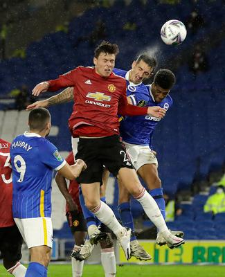 Manchester United's Victor Lindelof (left) battles with Brighton and Hove Albion's Lewis Dunk (centre) and Bernado. Photo: Matt Dunham/NMC Pool/PA Wire