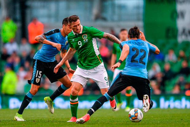Daryl Murphy of Republic of Ireland in action against Martin Caceres(R), and Matias Vecino of Uruguay. Photo by Eóin Noonan/Sportsfile