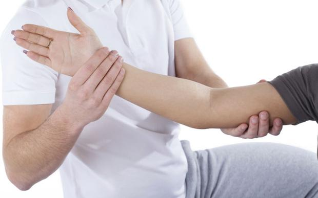 A physiotherapist bit a client's shoulder while she was lying on his table and growled