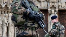 """French soldiers patrol in front of the Notre Dame Cathedral in Paris as part of the highest level of """"Vigipirate"""" security plan after Islamist attacks. REUTERS/Charles Platiau"""