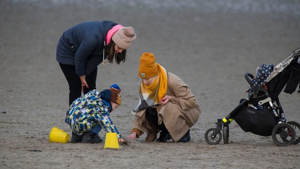 The mild weather brought out walkers – and sandcastle builders – at Sandymount strand yesterday. Photo: Colin O'Riordan
